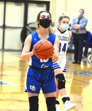 Sophomore Marlie Postula and the Mackinaw City varsity girls suffered their first loss of the season against St. Ignace in a 'Hooping for a Cure' game at St. Ignace on Saturday.