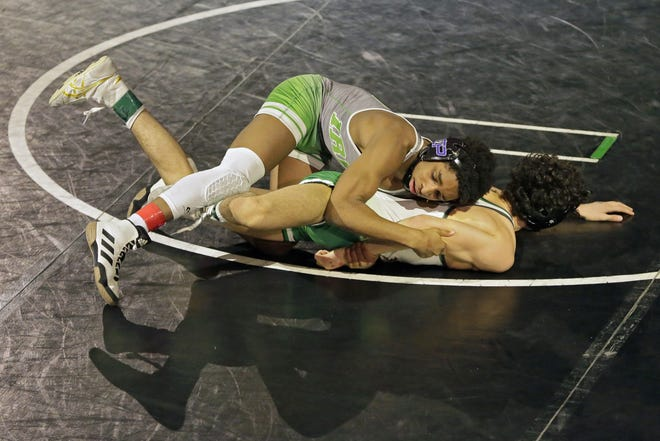 Ty Wilson, top, of Dublin Scioto defeated Omar Ayoub of Dublin Coffman to win the 113-pound title at the state wrestling meet and avenge his only two losses this season.