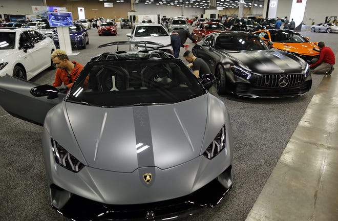 Detailers from Esoteric work on cars at the 2019 Columbus International Auto Show. The show has been canceled for the second straight year.
