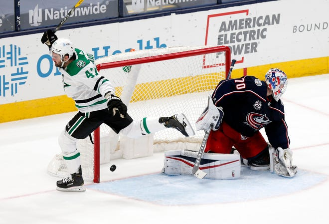 Dallas Stars forward Alexander Radulov, left, reacts after scoring against Joonas Korpisalo to lift his team to a 2-1 shootout victory Sunday at Nationwide Arena.