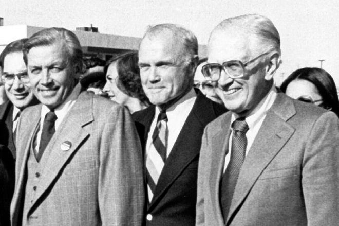 U.S. Senators Howard Metzenbaum, right, and John Glenn, center, put on brave faces while campaigning together in Youngstown in 1978 for fellow Ohio Democrats. The men had been bitter rivals who faced each other in two U.S. Senate primaries.