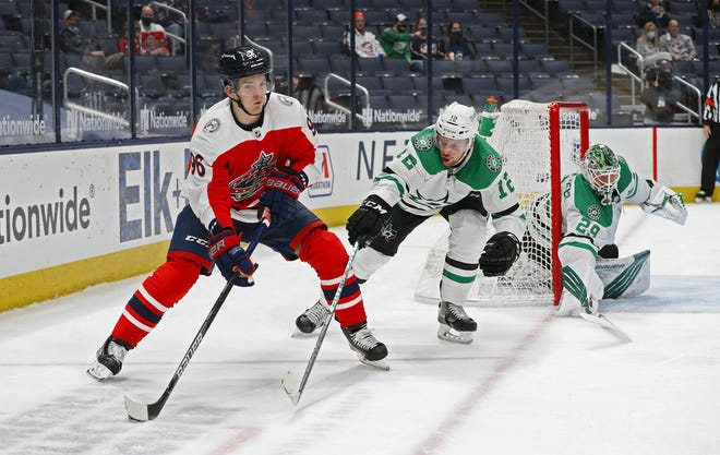 Blue Jackets center Jack Roslovic, left, had his second three-assist game in the NHL on Saturday, but he bemoaned his defensive mistakes as Columbus split a pair of weekend games against Dallas.