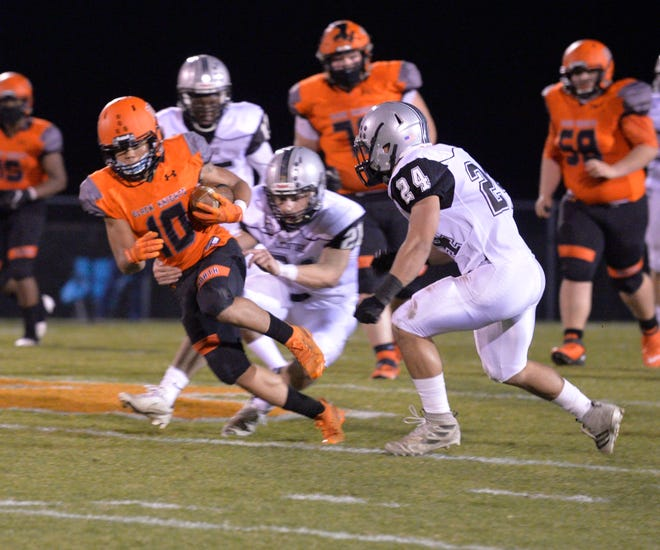 North Davidson's Ja'Mir McNeair runs after catching a pass in Friday's game with Ledford. [Mike Duprez/The Dispatch]