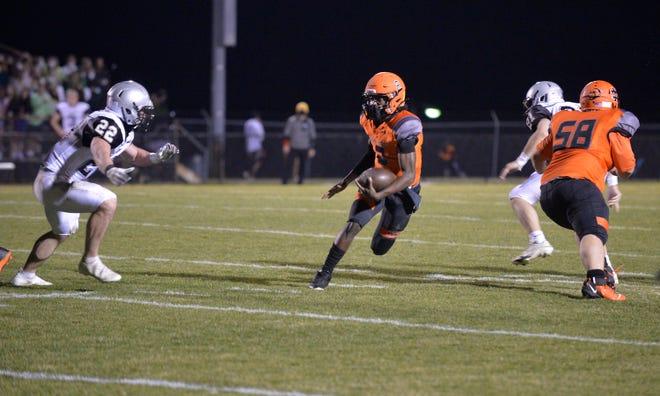 North Davidson quarterback Tedric Jenkins runs for big yardage against Ledford on Friday. [Mike Duprez/The Dispatch]