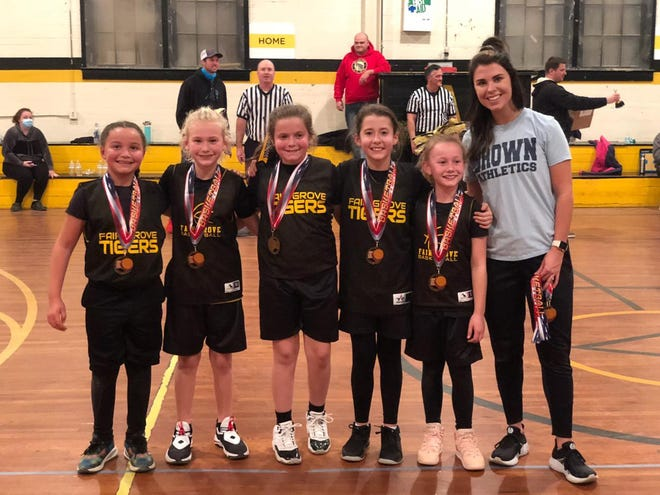 Fairgrove was the the fourth-grade girls runner-up in the Arcadia Basketball League tournament, held at the old Arcadia Elementary School gym. Team members are (from left)  Bella Douglas-Gerrow, Jalyn Causey, Reagin Hedrick, Naomi Spoon, Paitlyn Causey and coach Madi James. [Contributed photo]