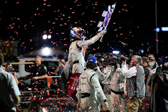 Jonathan Bomarito, Harry Tincknell and Ryan Hunter-Reay celebrate their victory in the 2020 Twelve Hours of Sebring in the No. 55 Mazda DPi.