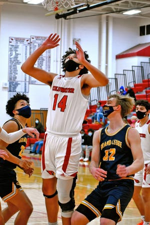 Coldwater's Evan Sloan goes in hard for a rebound versus Grand Ledge Saturday