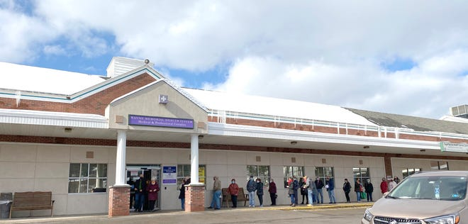 People wait in line for the COVID-19 vaccine at the Wayne Memorial Community Health Centers' site at the Stourbridge Professional Complex, Honesdale on February 5th.