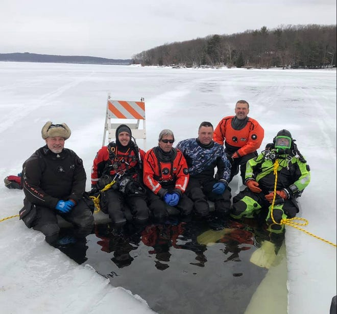 Tafton Dive & Rescue Team members line up at the underwater rescue drill on Lake Wallenpaupack, Feb. 26. From left: Bill, Nick, Rich, Charlie and Matt.