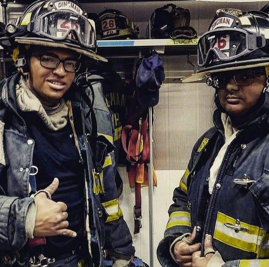 Dingman Township Volunteer Fire Department firefighters  Chriistian Santiago and Lucas Dindiyal.