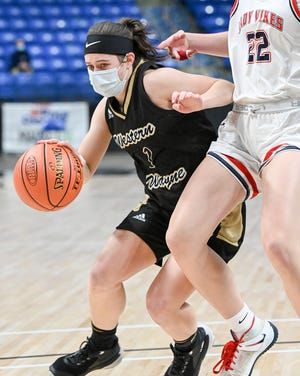 Wayne's Kaeli Romanowski (1) slashes her way through the lane during Saturday's District Two championship game against Riverside. The Lady 'Cats suffered a 59-32 loss to the Vikings.