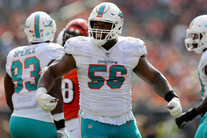 Miami Dolphins defensive tackle Davon Godchaux (56) reacts after making a tackle in the first quarter during the Week 5 NFL game between the Miami Dolphins and the Cincinnati Bengals, Sunday, Oct. 7, 2018, at Paul Brown Stadium in Cincinnati.