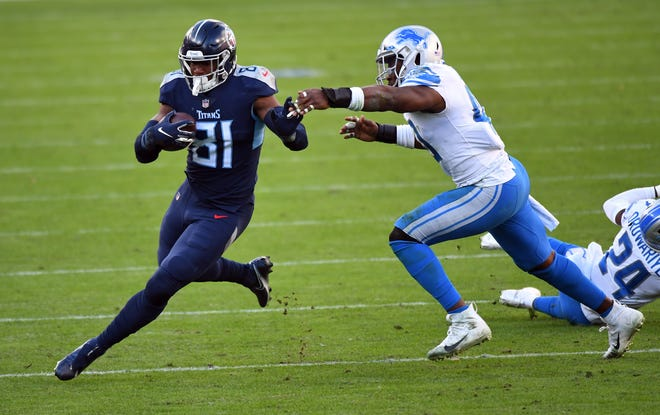 Dec 20, 2020; Nashville, Tennessee, USA; Tennessee Titans tight end Jonnu Smith (81) runs for a first down during the second half against the Detroit Lions at Nissan Stadium.