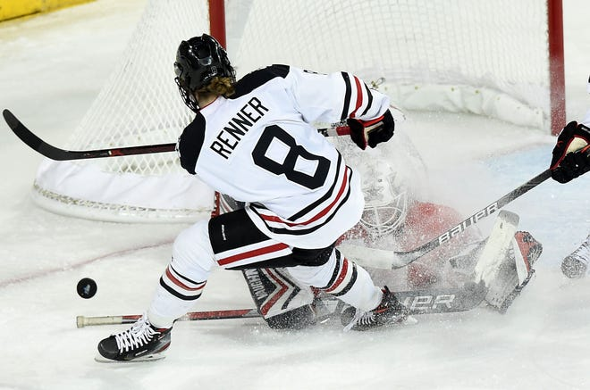 Robert Morris goalie Raygan Kirk makes a save on Northeastern's Andrea Renner in the second period of the quarterfinals of the National Collegiate Women's Hockey Championships on Monday at Erie Insurance Arena.