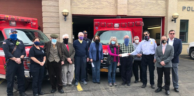 A gathering of Bethesda Foundation representatives, Hornell Fire Department personnel including Chief Frank Brzozowski and City of Hornell officials meet in front of the fire hall March 11. The Bethesda Foundation presented a $18,000 check to the fire department for a critically needed new ventilator. The foundation has presented some $87,000 to the Hornell Fire Department over the years to support the department's life saving mission.
