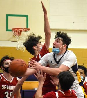Richfield Springs Indian Dylan Hosford shoots in a crowd during the fourth quarter of Saturday's season finale against Sauquoit Valley.