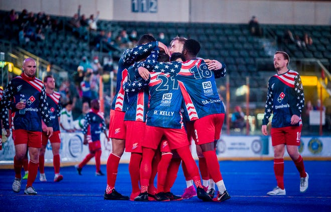Kansas City Comets forwards Robert Kelly (21) and Mike DaSilva (18) celebrate a goal with teammates in Sunday's game against the Dallas Sidekicks at Cable Dahmer Arena. The Comets routed Dallas 13-4 to clinch an MASL playoff berth.