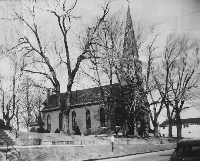 The original Holy Trinity Catholic Church was located on the corner of Main and Walnut streets for 107 years before being demolished.