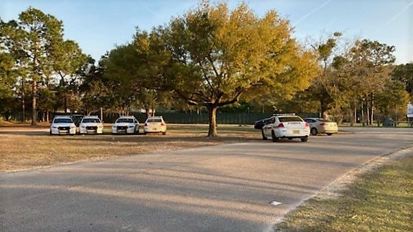 Police investigate a shooting at Mandarin's Greenland Park Sunday afternoon.