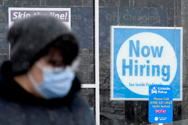 The hiring sign in this photo outside a Schaumburg, Ill. dry cleaner reflects the push businesses are making to grow their businesses after effects of the COVID-19 pandemic.