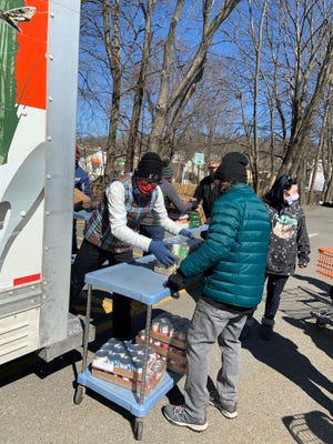 A group of hearty volunteers braved the chilly temps to help unload a food delivery from the Worcester County Food Bank at the Gardner CAC on March 15.