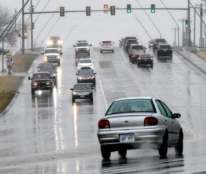 Motorists' headlights are reflected off the Kansas Avenue pavement Saturday during a period of heavy rain. Although Sunday was a break from the dreary weather, drizzle, fog and rain returned to the area for part of  Monday.