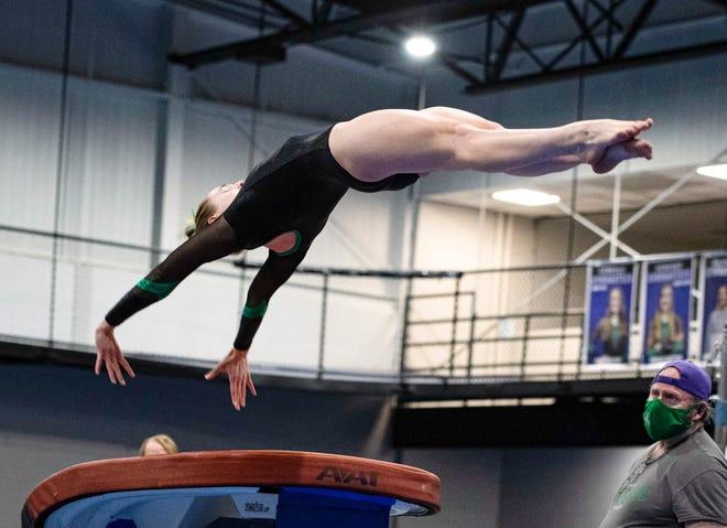 Senior Grace Girten competes on vault