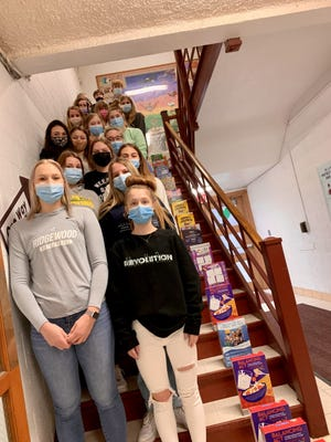 The Cambridge SALT group (Student Advisory Leadership Team) collected 220 boxes of cereal on National Cereal Day to be donated to the Cambridge Food Pantry. The boxes were lined up like dominoes and travelled on both floors of the high school.