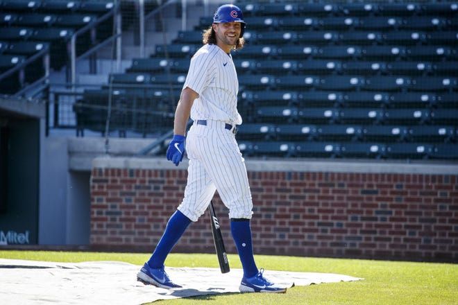 Chicago Cubs outfielder Jake Marisnick laughs after batting practice on Tuesday, Feb. 23, at Sloan Park in Mesa, Ariz.
