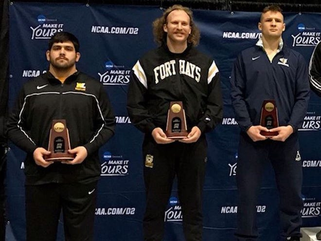 FHSU wrestler A.J. Cooper, middle, placed fifth at the Division II national tournament.