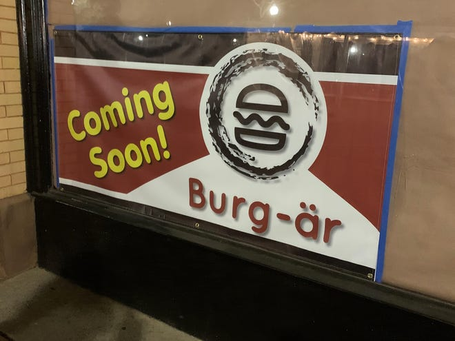 A sign for a new restaurant in the former Crepe Factory location on West Main Street in downtown Spartanburg.