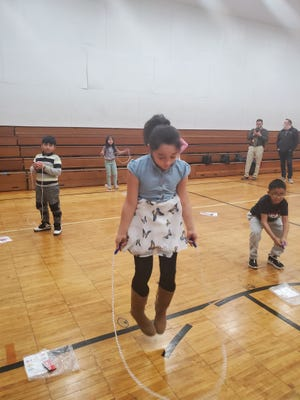 Andreya Lovell, a Franklin Elementary School third-grader, jumps rope during gym class Monday. Students at Massillon's Franklin and Canton City's Gibbs schools each received a jump rope through a donation from Midwestern Industries of Massillon and Chip and Lisa Painter.