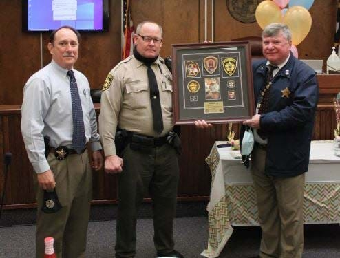 Dep. Bixby will be retiring from the Onslow County Sheriff's Office as of April 1. He currently serves as a bailiff in the Onslow County Courthouse and was given a farewell and birthday luncheon by his co-workers. He is pictured with Col. C. Thomas and Sheriff H. Miller.
