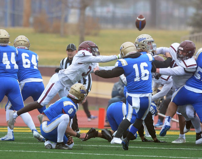 Bethel defensive back Trey Palmer misses a block on this kick, but blocks a field goal attempt and an extra-point kick in a 35-9 Bethel win.