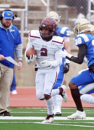 Bethel defensive back Dominic Brown returns a kickoff during play Saturday. Bethel wins the KCAC title for the first time since 2007.