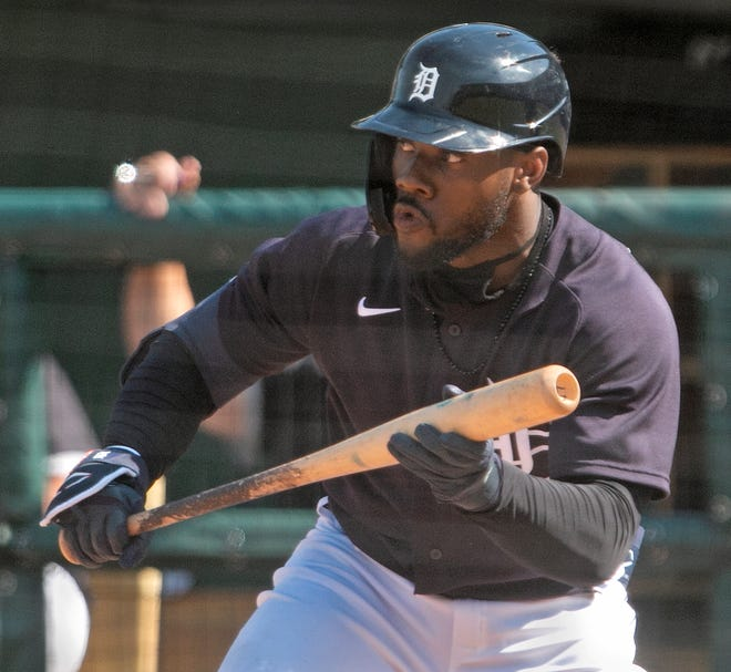 Detroit Tigers center fielder Akil Baddoo looks to bunt in a recent spring training game. He will lead off the Tigers line up Tuesday against the New York Yankees' Gerrit Cole.
