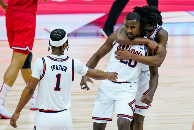 Illinois guard Da'Monte Williams (20) is hugged from behind by guard Ayo Dosunmu (11) and they celebrate with Illinois guard Trent Frazier (1) during the second half of an NCAA college basketball championship game against Ohio State at the Big Ten Conference tournament, Sunday, March 14, 2021, in Indianapolis.