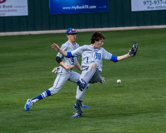 Midlothian outfielders Fletcher Newman (9) and Hunter Rainwater (1) narrowly avoid a collision during a recent game.