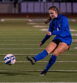 Midlothian's Allyson Gibbs (8) boots the ball downfield during a January home match. Gibbs scored two goals as the Lady Panthers routed Ennis, 7-0, to clinch the District 14-5A championship.