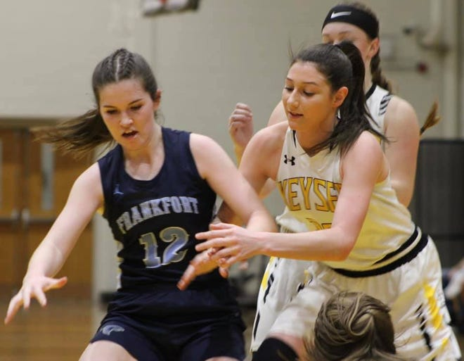 Frankfort's Arin Lease and Keyser's Kaili Crowl battle for position in an effort to secure a loose ball.