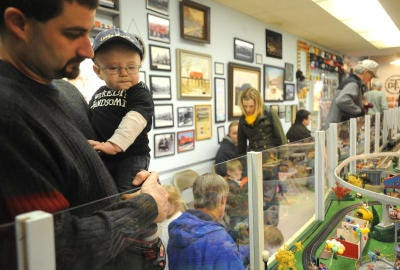 Darren Capps and son, Ben Elliott, 8 months, from Allen Park take in train displays during an event at the Flat Rock Train Depot & Museum for students and families enrolled in the T.O.T.E. (Teach Our Tots Early) program in 2009. The Downriver class for children under 5 with varying degrees of disabilities was one of many youth activities held in the Downriver Area before COVID-19.