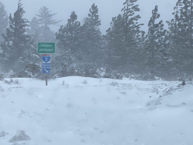 Wind blows snow sideways at about 8:15 Monday morning, March 15, 2021 at the Interstate 5 north onramp at Abram's Lake.