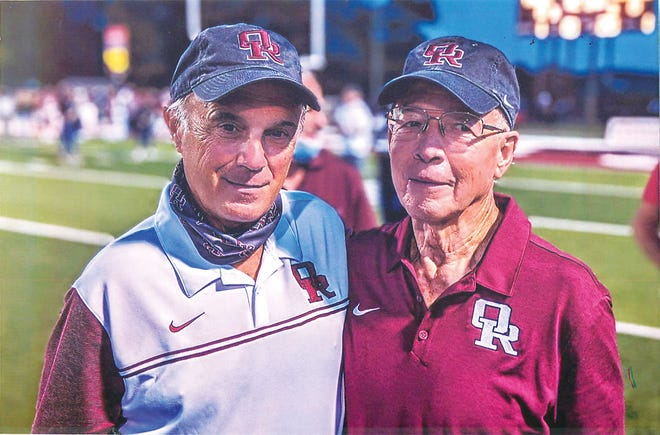 Mike Kelly shot the great photo of current Wildcats head Coach Joe Gaddis, left, and former Coach Emory Hale on the field on Oct. 23, 2020.