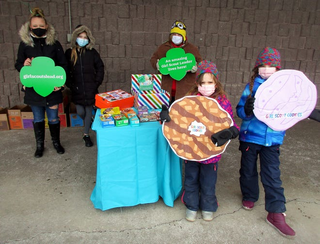 Sharing the Girl Scout cookies goodness March 6 at Parry's General Store in Hamilton are, front from left, Emma Hartpence and Lily Hartpence and back, from left, Lexi Mordus, Cadance Clemens and Madyson Decock. Girl Scouts will be back to sell their cookies from 10 a.m. to 1 p.m. March 20 at Cooley's Do It Best Home Center at 9 Cambridge Ave. in Morrisville.