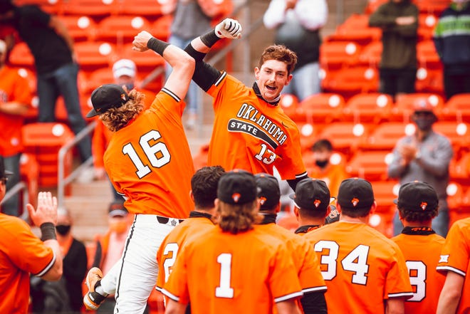 Conor Gore (16) and Nolan McLean (13) celebrate during the Cowboys' 10-6 win over Vanderbilt at Cecil O'Brate Stadium on Sunday in Stillwater.