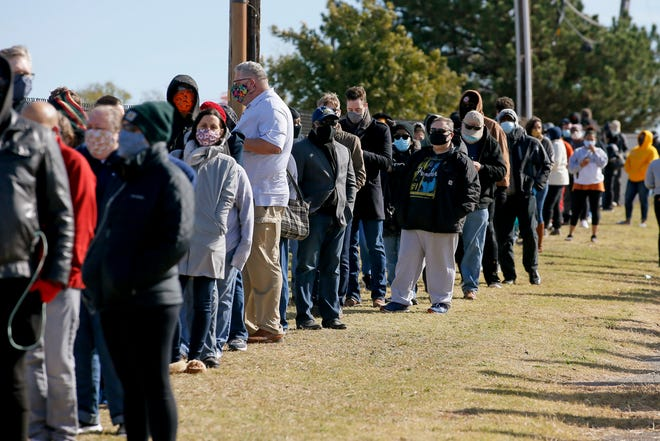 Voters wait in line outside the Oklahoma County Election Board on the last day of early voting in Oklahoma City, Saturday, Oct. 31, 2020. [Bryan Terry/The Oklahoman]