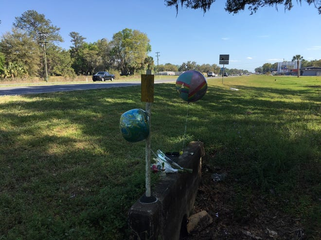 Mourners set up this small tribute site on Sunday near the spot where a 20-year-old Ocala woman was hit by a car and killed. The site is on the west edge of South Pine Avenue (U.S. 441) just north of the Ocala Drive-In.