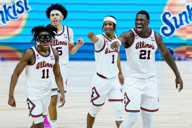 Illinois players Ayo Dosunmu (11), Andre Curbelo (5), Trent Frazier (1), and Kofi Cockburn (21) wave to fans in the closing minute of overtime in an NCAA college basketball championship game at the Big Ten Conference tournament, Sunday in Indianapolis. Illinois defeated Ohio State  in overtime.