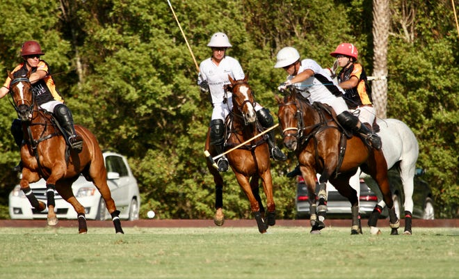 MVP Pablo MacDonough of Richard Mille drives downfield with Gringo Colombres and Santi Torres defending.