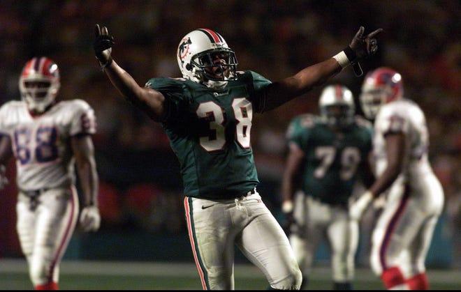 Dolphins defensive back Calvin Jackson celebrates after sacking Buffalo's Doug Flutie in 1999.